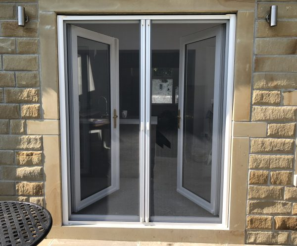 Double retractable insect screen doors